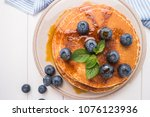 stack of pancakes with fresh... | Shutterstock . vector #1076123936