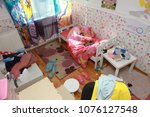 mess in the room. scattered... | Shutterstock . vector #1076127548