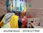 mess in the room. scattered... | Shutterstock . vector #1076127560