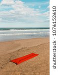 Small photo of Beach concept with red air mattress