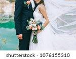loving couple holding hands... | Shutterstock . vector #1076155310