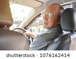 relaxed asian senior man in... | Shutterstock . vector #1076162414