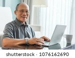 relaxed asian senior man using... | Shutterstock . vector #1076162690