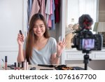 asian young female blogger... | Shutterstock . vector #1076167700