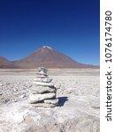 rock tower infront of volcan... | Shutterstock . vector #1076174780