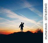silhouette of a man watching... | Shutterstock . vector #1076185643