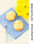 cupcakes with yellow cream... | Shutterstock . vector #1076192408