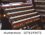 Small photo of Wooden piano in a catholic cathedral