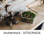 golden wedding rings lie on... | Shutterstock . vector #1076196626