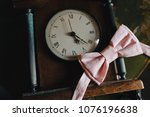 pink bow tie lies on a vintage... | Shutterstock . vector #1076196638