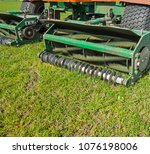 large motor mower mows green... | Shutterstock . vector #1076198006
