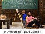 teacher looking at kid wiping...   Shutterstock . vector #1076228564