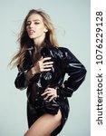 girl with long hair wears black ... | Shutterstock . vector #1076229128
