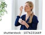 shot of beautiful young woman... | Shutterstock . vector #1076231669