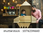kid happy sit in cardboard hand ... | Shutterstock . vector #1076234660