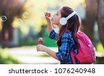 schoolgirl on the way to home.... | Shutterstock . vector #1076240948