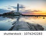 Beautiful sunrise over the lighthouse on St Mary