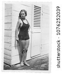 1934  young woman in swimsuit | Shutterstock . vector #1076252039