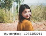 young asian woman feeling happy ... | Shutterstock . vector #1076253056