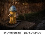 yellow city hydrant  | Shutterstock . vector #1076293409