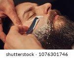 bearded male sitting in an... | Shutterstock . vector #1076301746