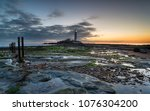 dawn over st mary's island and... | Shutterstock . vector #1076304200