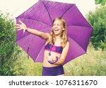 Preteen Girl With Umbrella In...
