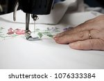 hands of woman working on the... | Shutterstock . vector #1076333384