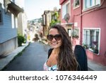 young woman with case for a... | Shutterstock . vector #1076346449