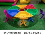 colorful round plastic table...   Shutterstock . vector #1076354258