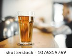 beer glass stands on bar... | Shutterstock . vector #1076359769