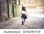 little girl running down a... | Shutterstock . vector #1076394719