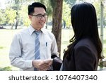 Small photo of Businessman and woman shake hands after business meeting closeup. A happy business start up welcome, introduction, greet or thanks gesture, partnership approval, dealing, greeting and partner concept.