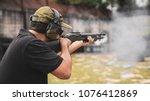man shooting on an outdoor... | Shutterstock . vector #1076412869