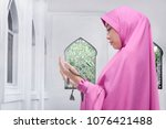 pretty asian female muslim... | Shutterstock . vector #1076421488