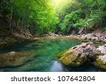 river deep in mountain forest.... | Shutterstock . vector #107642804