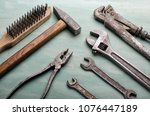 old tools set on a painted board | Shutterstock . vector #1076447189
