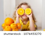child with oranges. happy... | Shutterstock . vector #1076453270