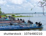 tourist boat on the lake... | Shutterstock . vector #1076480210