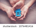 adult and child hands holding... | Shutterstock . vector #1076481416