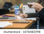 closeup businesswoman hand... | Shutterstock . vector #1076482598