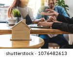 closeup house model over the... | Shutterstock . vector #1076482613