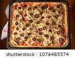 homemade rectangular pizza... | Shutterstock . vector #1076485574