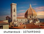 Florence, Tuscany / Italy. - April 23, 2018. Streets of Florence at sunset, far away you can see the Cathedral of Santa Maria Del Fiore - stock photo