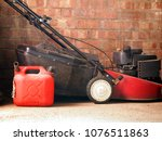 lawnmower against a brick wall... | Shutterstock . vector #1076511863