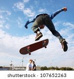 Skater Jumps High In Air Unde...