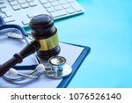 Small photo of Gavel and stethoscope. medical jurisprudence. legal definition of medical malpractice. attorney. common errors doctors, nurses and hospitals make.