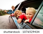 happy kids travel by car on... | Shutterstock . vector #1076529434