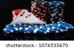 Small photo of two aces and poker chips, on a black background, with mappings
