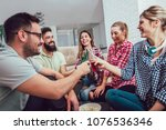 group of happy young friends... | Shutterstock . vector #1076536346